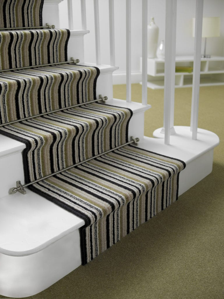 Sphere stair rods in pewter fitted on striped runner carpet