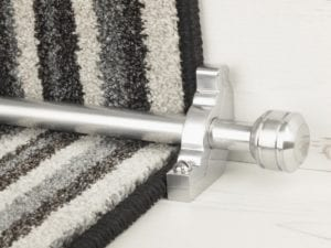 Brushed Chrome Piston stair rod on striped runner carpet