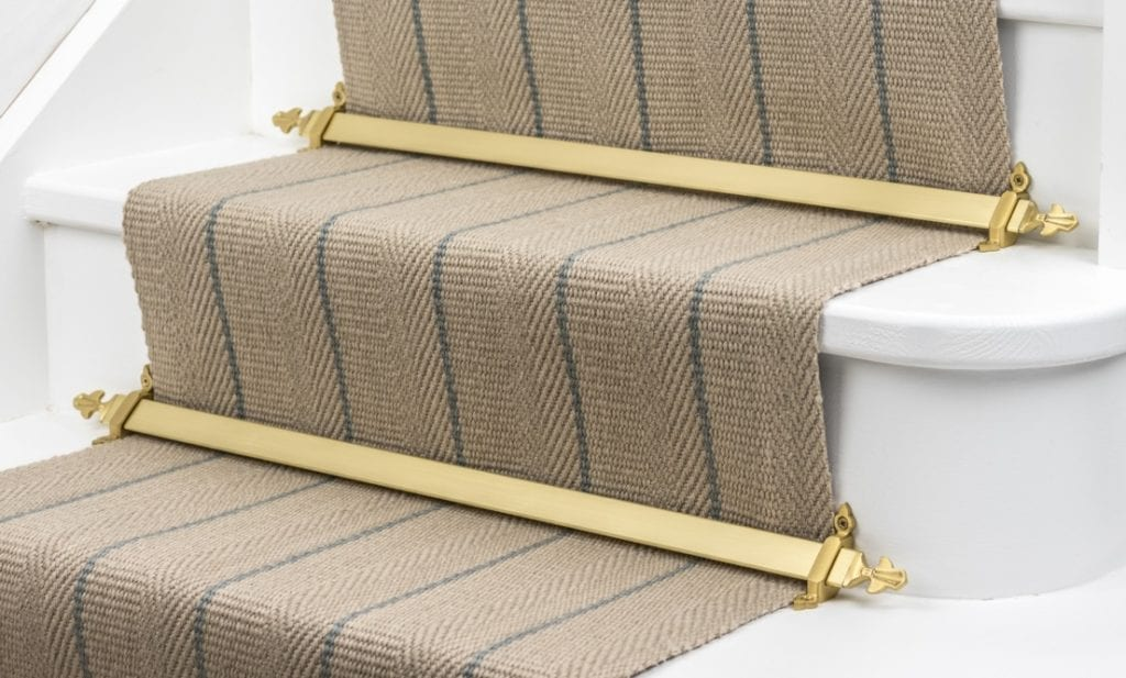 Louis stair carpet bars in polished brass on striped, natural runner