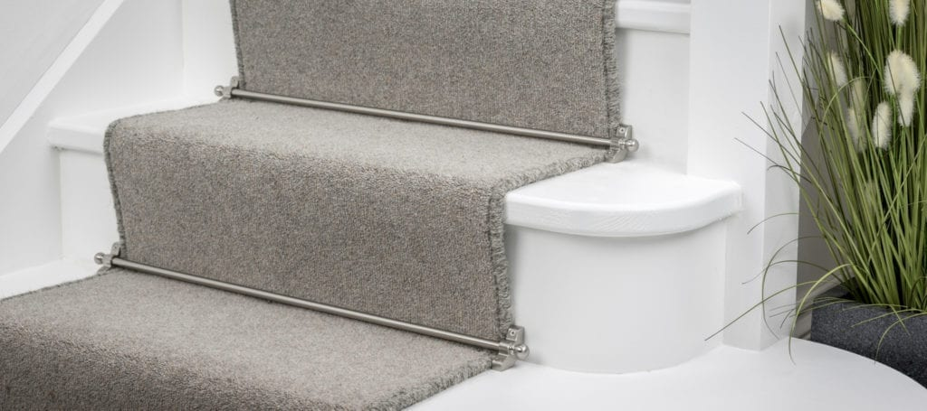 The latest trends in stair rods includes 9mm Jubilee carpet rods shown on grey runner carpet