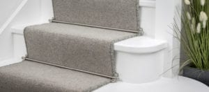 Jubilee carpet rods shown on grey runner carpet
