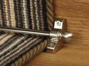 Jubilee runner carpet rod in satin nickel finish on striped runner