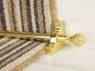 Extra large Dune stair rods on striped carpet