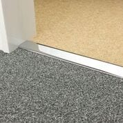 Premier Double Z9 door threshold joins two carpets in a doorway, chrome