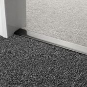 Premier Double Z9 door threshold joins two grey carpets in a doorway, pewter