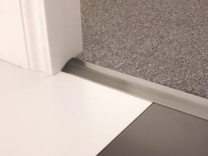 Carpet ramp joins different levels of flooring, carpet to tiles, pewter