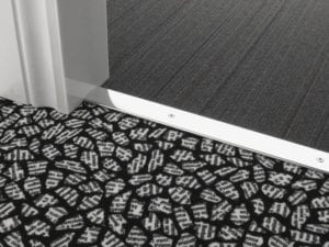 Premier Cover door plate with matching screws, connecting carpet to carpet flooring, chrome