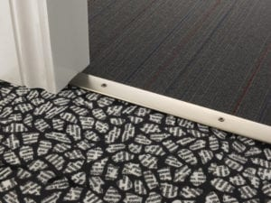 Premier Cover door plate with matching screws, connecting carpet to carpet flooring, pewter