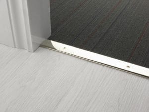 Premier Cover door plate with matching screws, connecting laminate to carpet, polished nickel