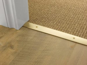 Premier Cover door plate with matching screws, connecting laminate to sisal flooring Satin Brass