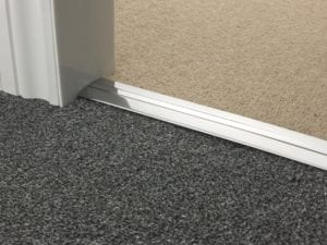 Premier Posh metal transition strip with inlay covering screws, joins two carpets, Brushed Chrome