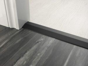 Premier 2 Way Ramp sloping door threshold, shown from laminate to vinyl, black