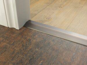 Premier 2 Way Ramp sloping door threshold, shown from laminate to vinyl, antique bronze