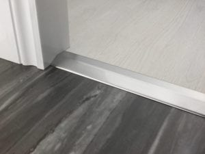 Premier 2 Way Ramp sloping door threshold, shown from laminate to vinyl, brushed chrome