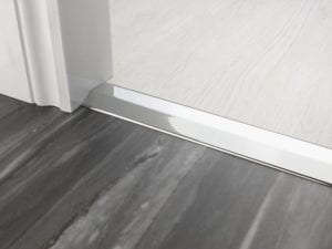 Premier 2 Way Ramp sloping door threshold, shown from laminate to vinyl, chrome