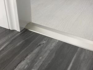 Premier 2 Way Ramp sloping door threshold, shown from laminate to vinyl, satin nickel
