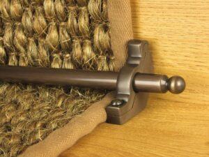 Windsor stair rod in antique bronze shown on seagrass runner