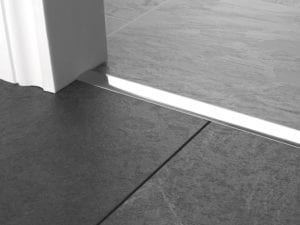 Premier T Bars, 25mm wide, sits between two tiled floors, brushed chrome