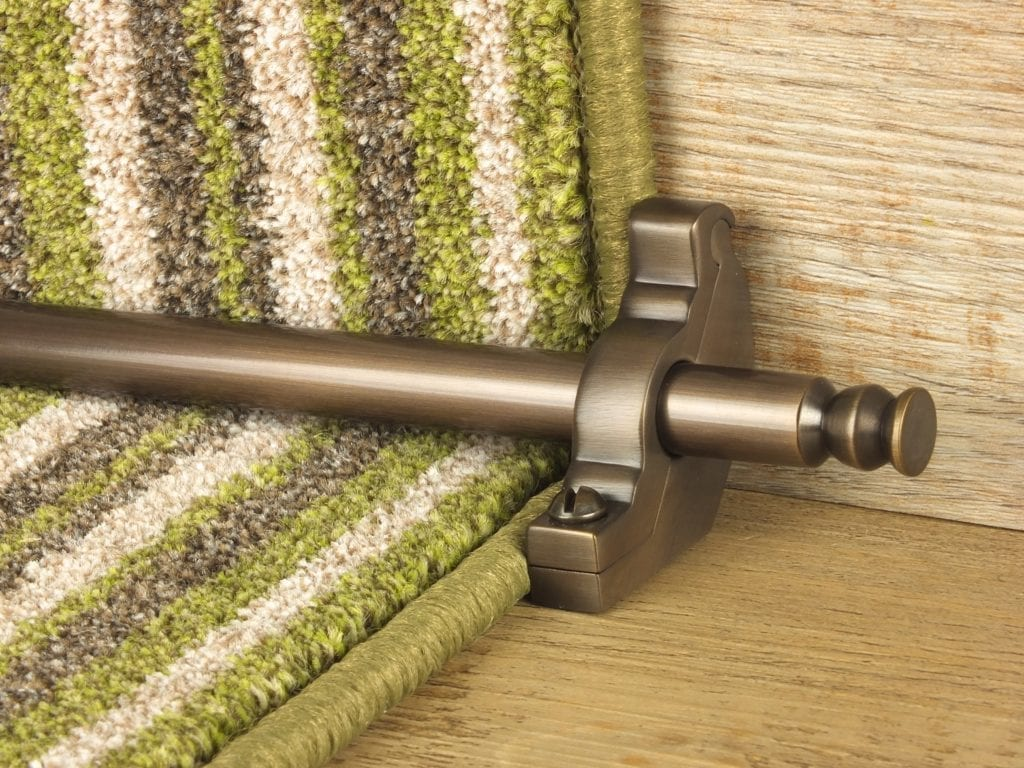 Balmoral stair rod with bracket on striped green stair runner