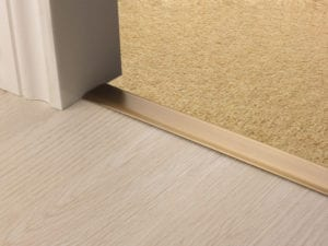 Premier Z door bar, neatly joining carpet to tiles, quality antique brass