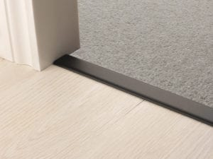 Premier Z door bar, neatly joining carpet to tiles, quality black finish