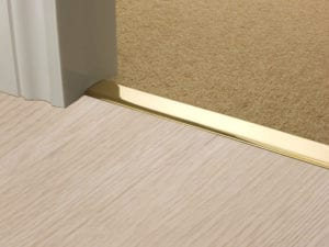 Premier Z door bar, neatly joining carpet to tiles, quality polished brass