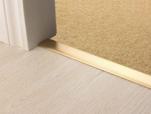 Premier Z door bar, neatly joining carpet to tiles, quality satin brass