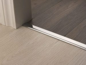 Premier Vinyl Edge floor edging, self-adhesive, shown between vinyl & timber, brushed chrome