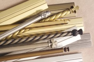 Stair Rods & Door Thresholds - selection in a pile on the floor