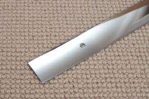 Premier Cover door plate lying on top of beige carpet