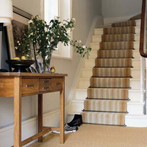 Flight of carpeted stairs, Premier runner rods