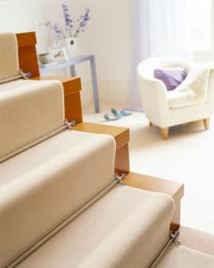 Crystal Sky runner carpet rods fitted up open-plan staircase with cream runner