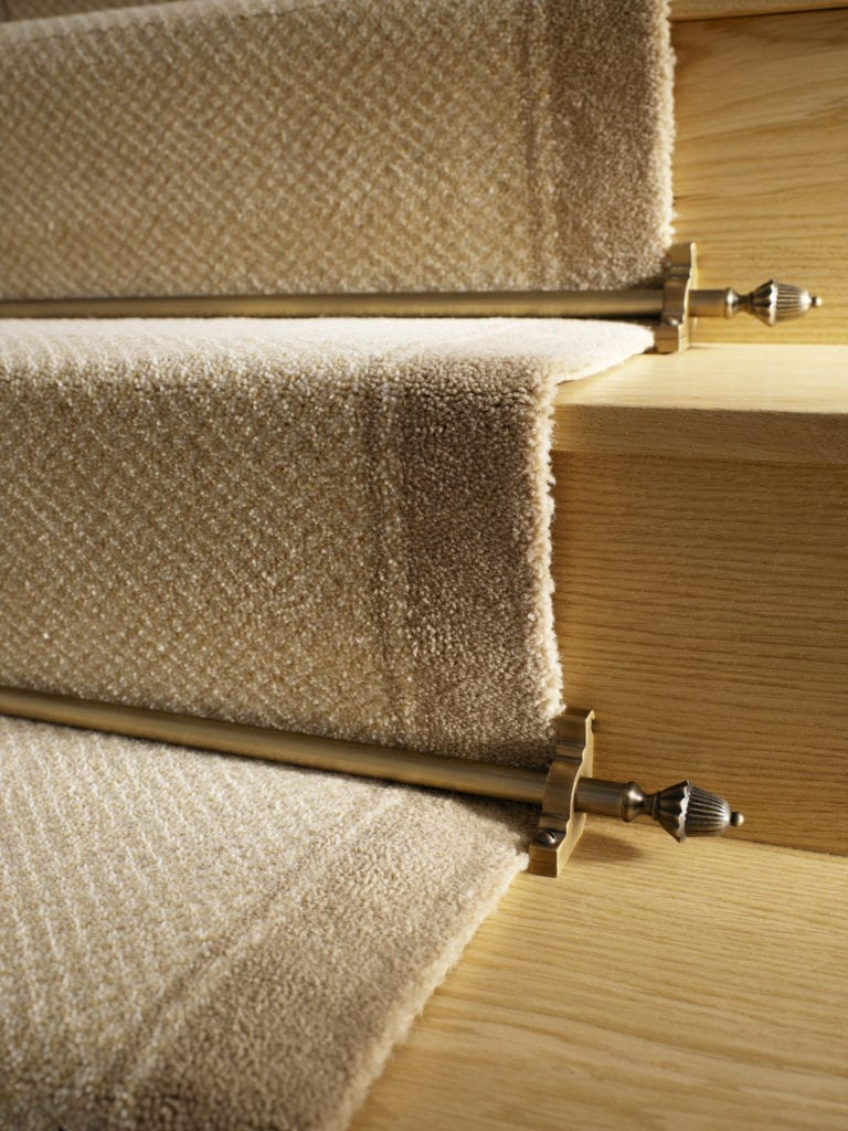 Dubair stair rods in antique brass on carpet stair runner
