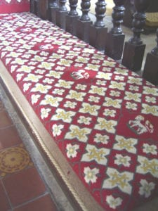 Church pew cushion, tapestry design edged with Easybind