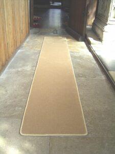 Church stair runner edged with Easybind carpet trim
