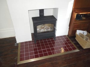 red tiled hearth edh=ged with Premier Posh floor tirm