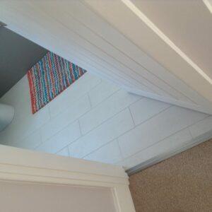 lino bathroom floor joined to landing carpet with Prmier Posh door bar in chrome finish