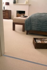 carpet door threshold, Premier Double Z9, elegantly joins two beige carpets from landing into bedroom