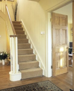 Lancaster solid antique brass runner rods fitted up cream painted staircase