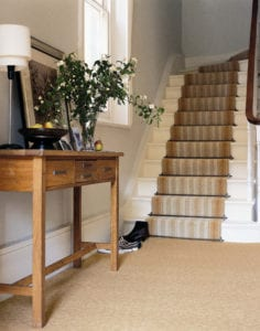 Premier solid brass runner carpet rod, striped stair runner, beige hall carpet and table