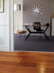 Blue patterned carpet joined to laminate hallway with Premier Z flooring trim in chrome