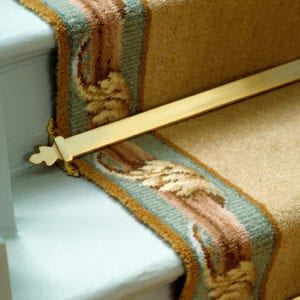 Beaumont stair rods in polished brass on bordered runner, green step