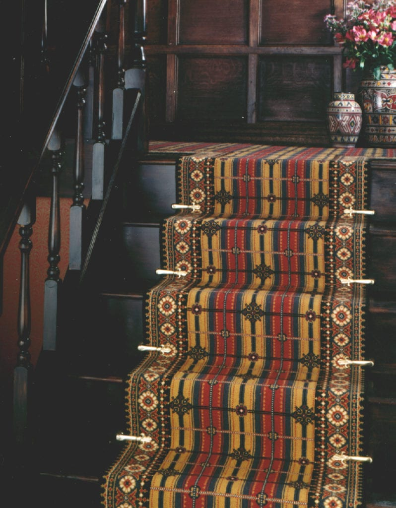 Victorian stair carpet clips enhance a runner stair carpet