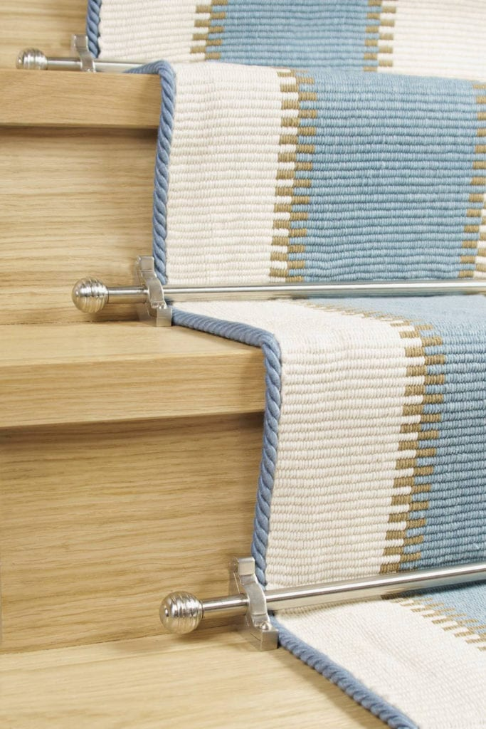 Vision Sphere stair rod shown in satin nickel on blue striped runner