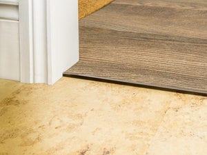 bvinyl door thresholds in antique bronze joining LVT