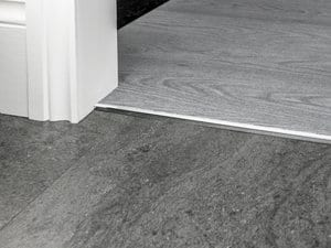 vinyl door threshold in chrome joining LVT