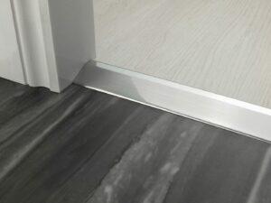 Premier Ramp door bar in brushed chrome connecting two different floor levels in a doorway