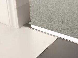 Premier Z chrome flooring joiner between tiles and a carpet