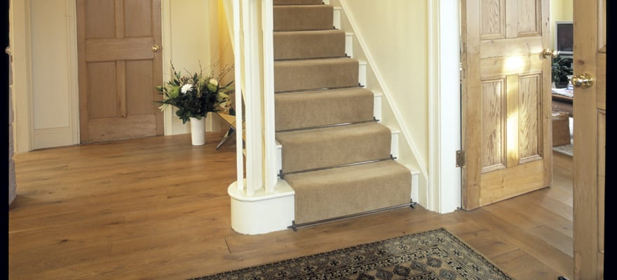 Lancaster antique brass stair rods fitted in hall