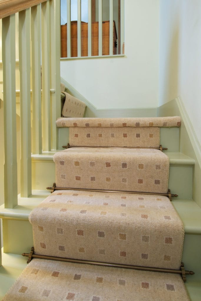 Chatsworth brass stair rods on runner carpet & green staircase